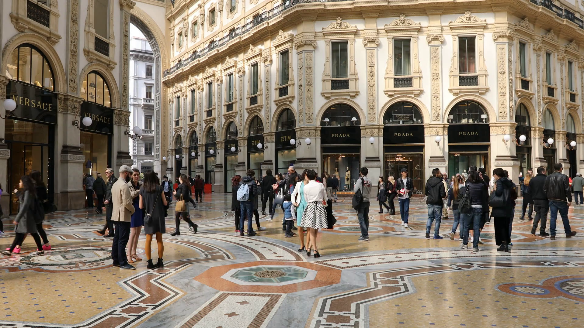 tourists-walking-for-shopping-inside-the-galleria-vittorio-emanuele-ii-gallery-in-piazza-duomo-square-famous-fashion-stores-like-prada-luxury-and-shopp
